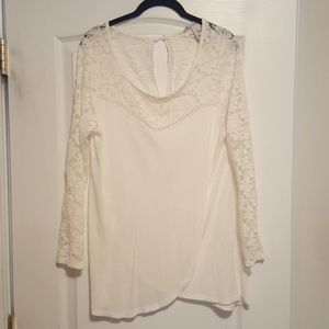 Pretty top with lace accents.  Long fitting with 2